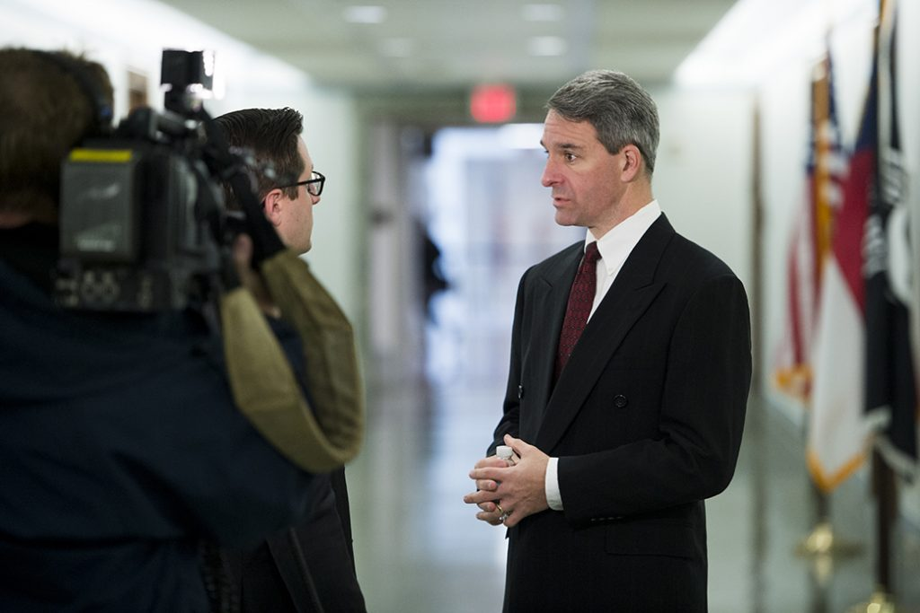Ken Cuccinelli, former Virginia attorney general, does a TV interview before a congressional subcommittee hearing on gun control, January 2015.