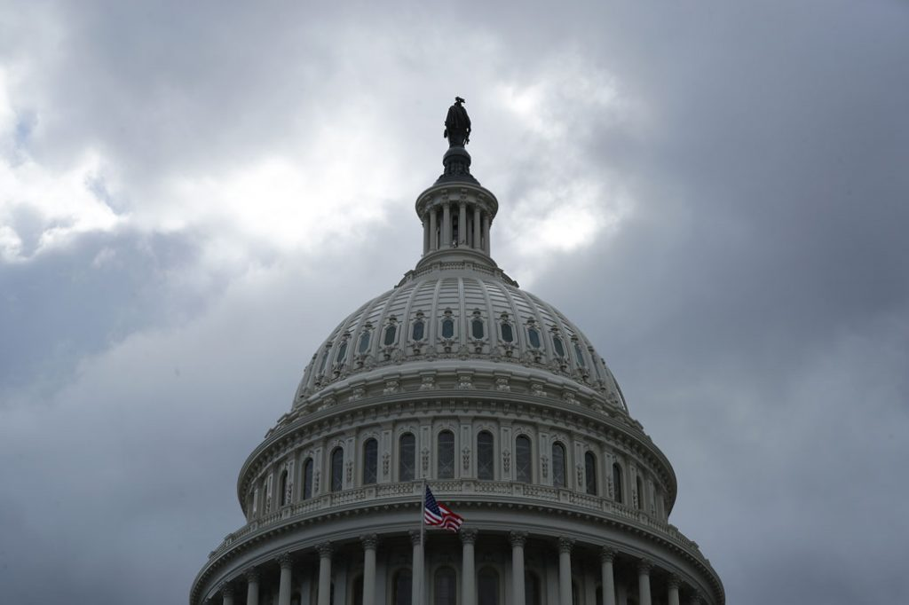 Dark clouds move over the Statue of Freedom on top of the U.S. Capitol Dome, May 2019.