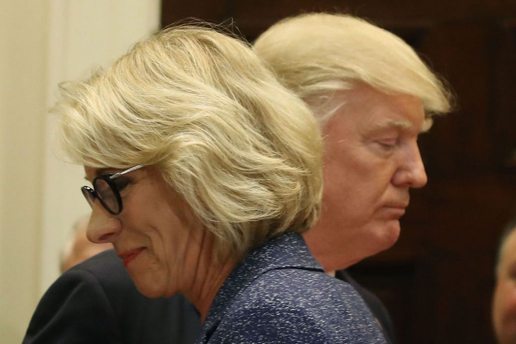 President Donald Trump and U.S. Secretary of Education Betsy DeVos are pictured in the Roosevelt Room at the White House, Washington, D.C., April 2017.
