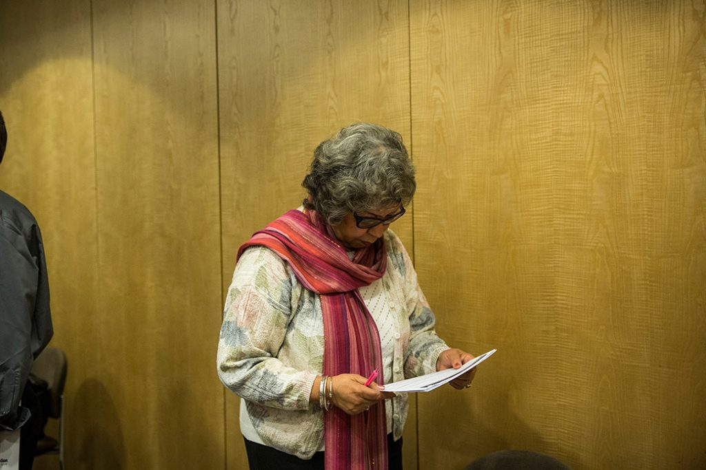 A woman prepares to speak to potential employers, November 2013, in New York City.