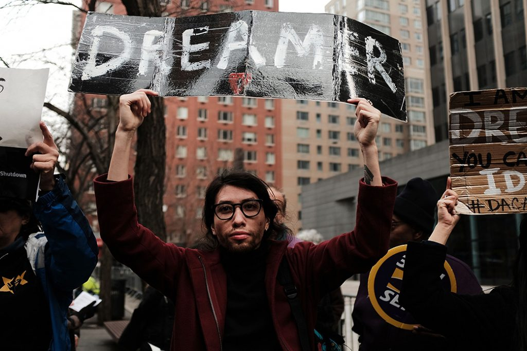 Demonstrators, many of them recent immigrants to America, protest the government shutdown and the lack of a deal on DACA, January 2018, in New York City.