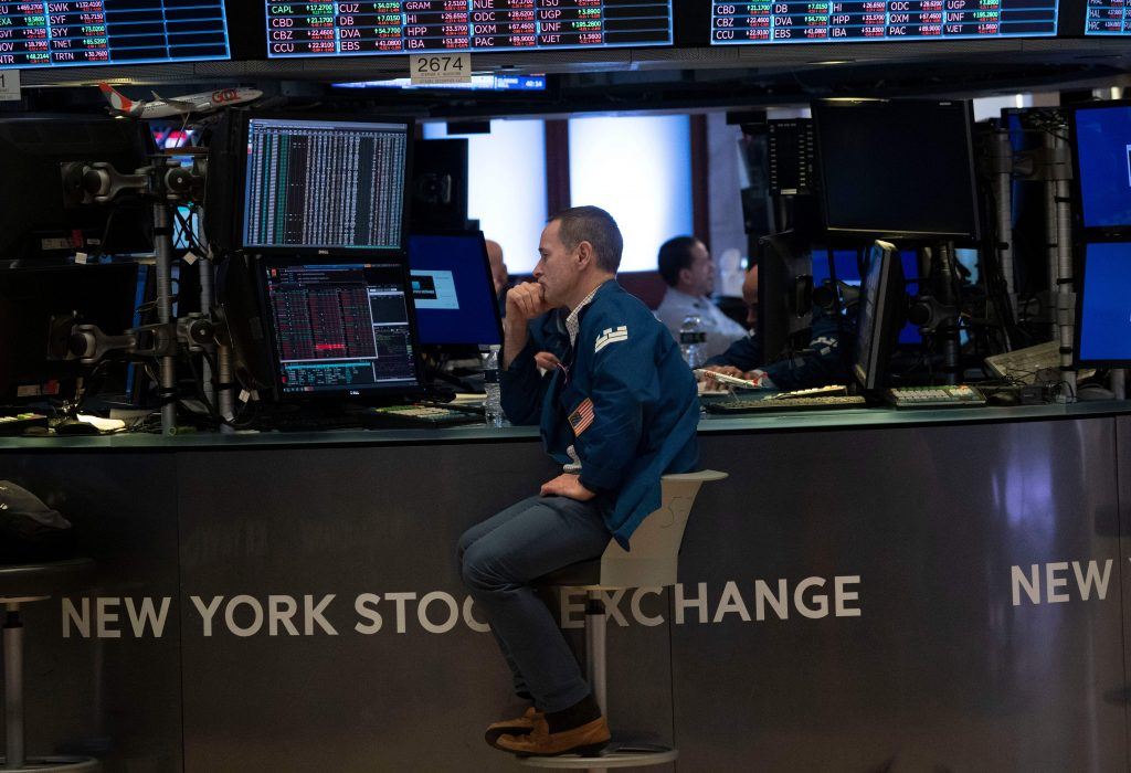 Traders work the floor of the New York Stock Exchange on August 23, 2019 in New York. - Wall Street stocks tanked Friday after President Donald Trump vowed a tough response to new Chinese tariffs, escalating the trade war between the world's top two economies amid rising fears of recession. The Dow Jones Industrial Average sank more than 600 points, or 2.4 percent, to 25,628.90, registering its fourth straight weekly loss. (Photo by Don Emmert / AFP)        (Photo credit should read DON EMMERT/AFP/Getty Images)