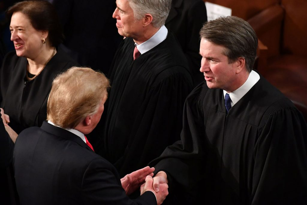 President Donald Trump shakes hands with Supreme Court Justice Brett Kavanaugh at the U.S. Capitol in Washington, February 2019.