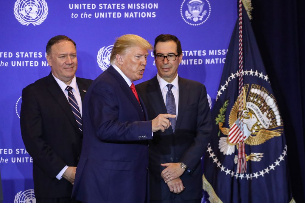 U.S. President Donald Trump is flanked by Secretary of State Mike Pompeo and Secretary of the Treasury Steven Mnuchin during a press conference in which he defended his July 25 phone call with Ukrainian President Volodymyr Zelensky, New York City, September 25, 2019.