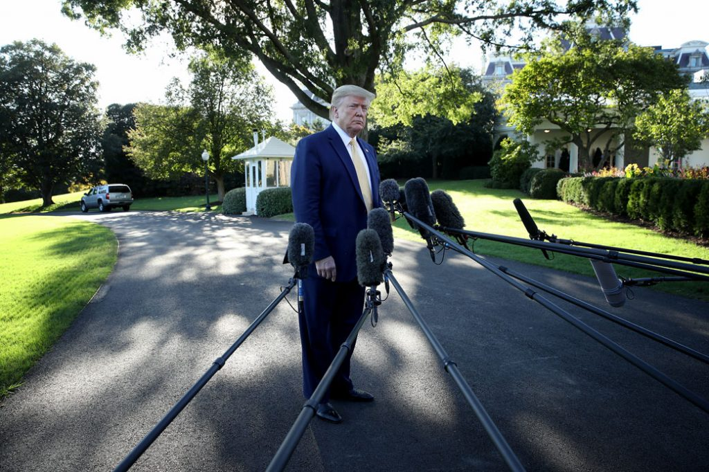 President Donald Trump answers questions from the media while departing the White House on October 11, 2019, Washington, D.C.