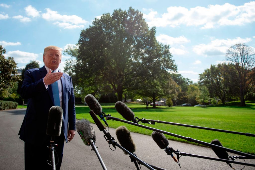 U.S. President Donald Trump speaks to the press as he departs the White House in Washington, D.C., on October 4, 2019.