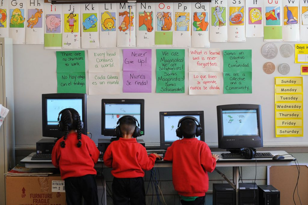 Kindergarten students at a Denver, Colorado, charter school play educational computer games during class, December 2011.