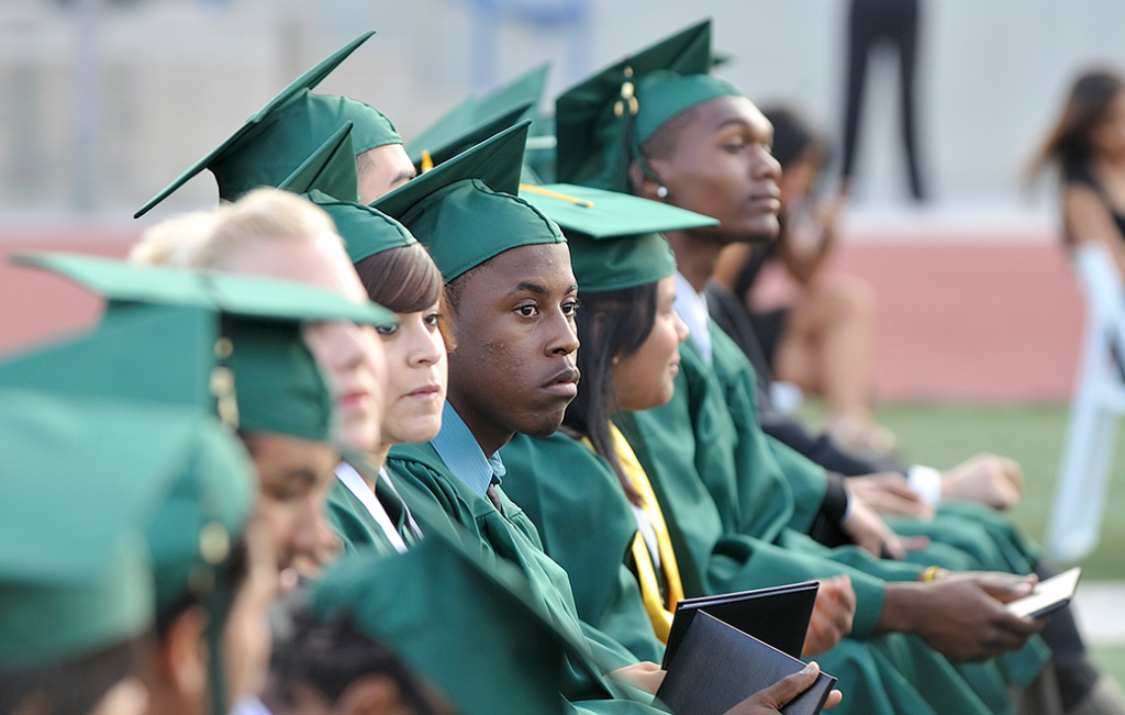 High school students sit for their commencement ceremony in Long Beach, California, June 2009.