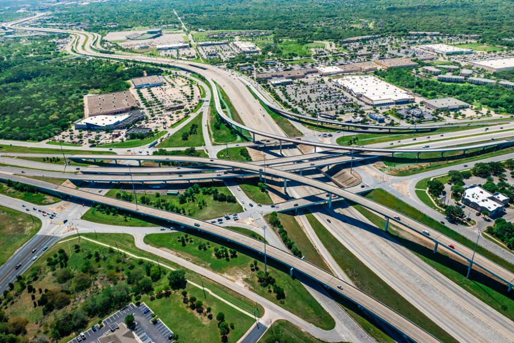 A spaghetti highway overpass intersection and shopping center in Austin, Texas.