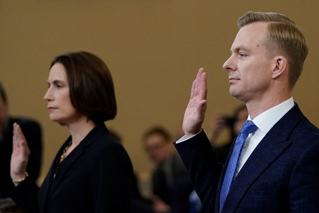 Fiona Hill, the National Security Council's former senior director for Europe and Russia, and David Holmes, an official from the American embassy in Ukraine, are sworn in prior to testifying before the House Intelligence Committee in Washington, D.C., November 21, 2019.