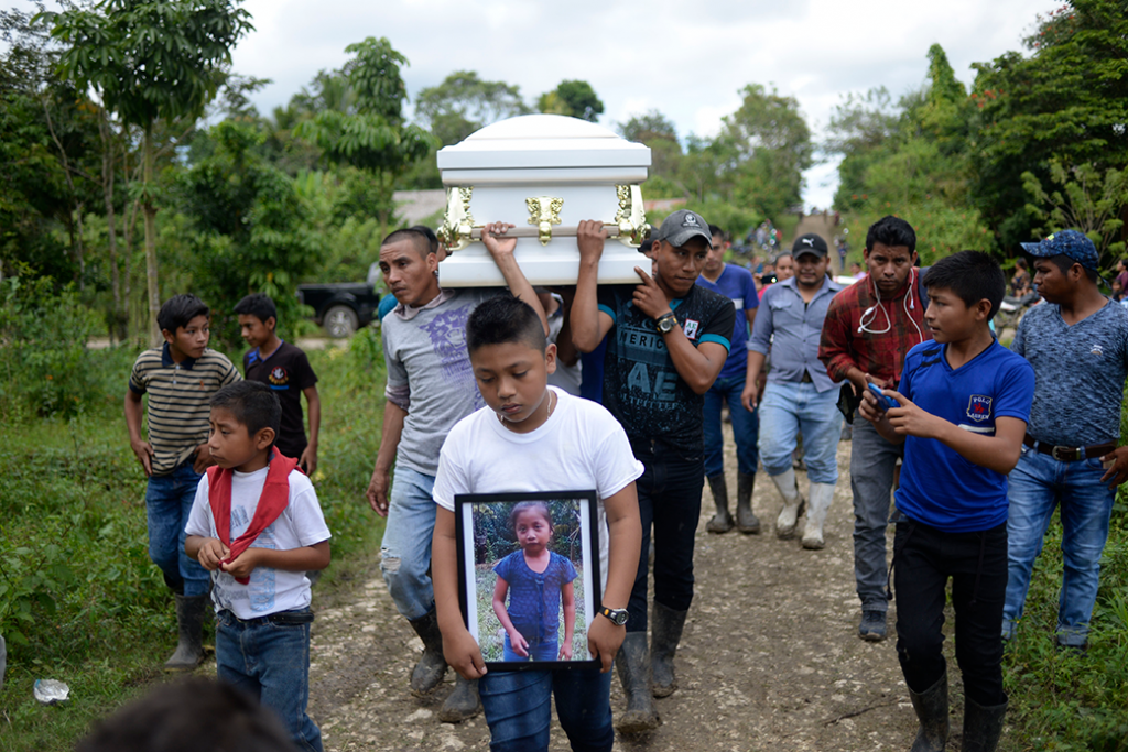 A boy carries a picture of Jakelin Caal, a Guatemalan boy who died in a Texas hospital two days after being taken into custody by U.S. Border Patrol agents, December 6, 2019.