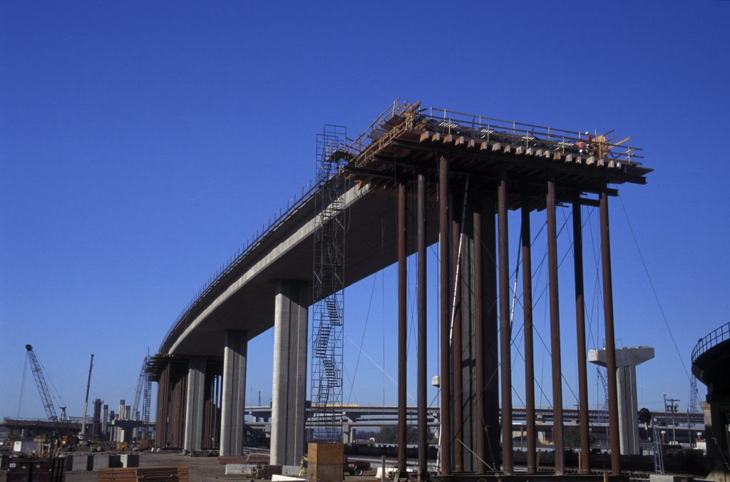 Freeway bridge under construction showing falsework.