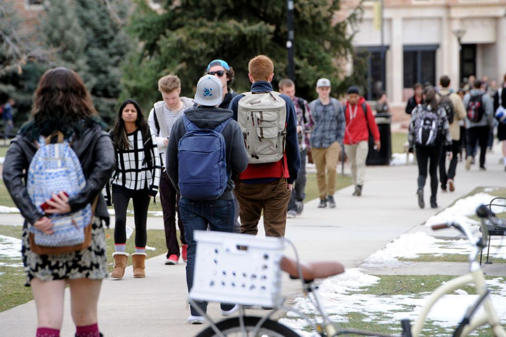 Students walk between classes at their college campus in Boulder, Colorado, February 2015.
