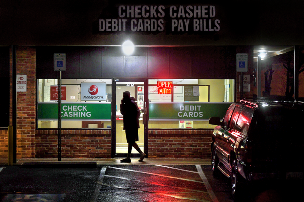 A customer leaves a payday loan store in Gaithersburg, Maryland, February 2019.