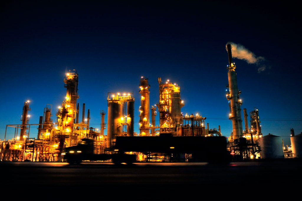 An oil refinery lights up the night sky in Three Rivers, Texas.