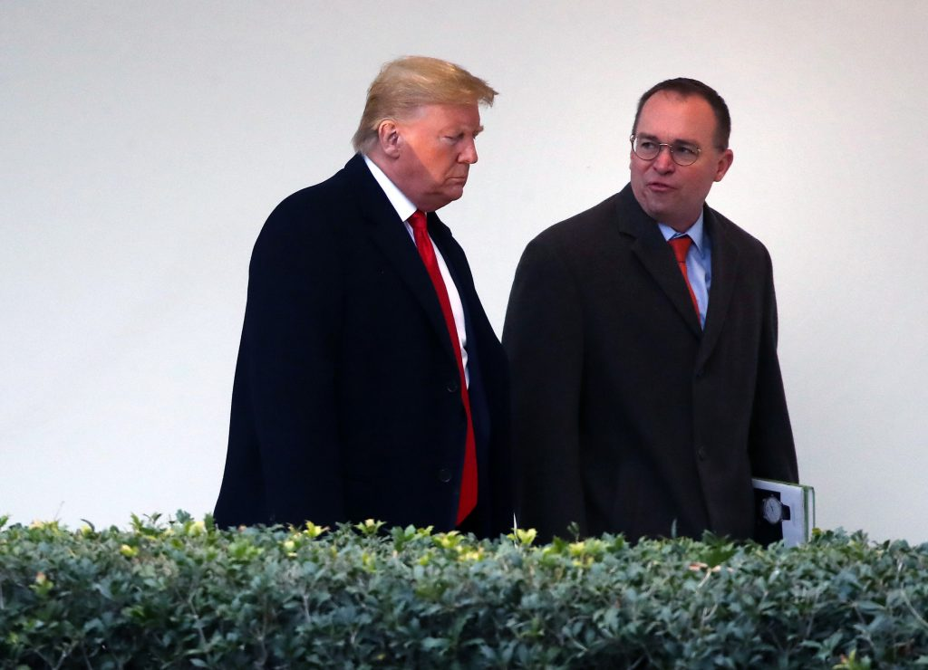 President Donald Trump walks along the West Wing Colonnade with acting White House chief of staff Mick Mulvaney, January 2020.
