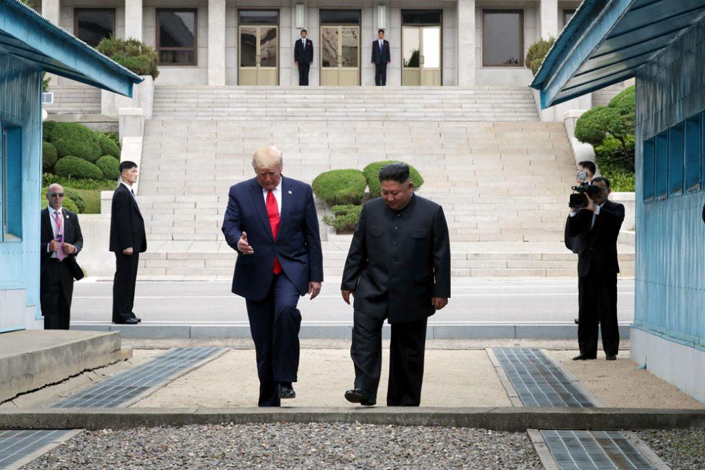 U.S. President Donald Trump and North Korean leader Kim Jon Un meet inside the Demilitarized Zone (DMZ) separating South and North Korea, on June 30, 2019.