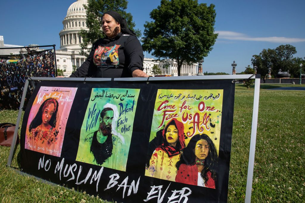 A member of the Justice for Muslims Collective protests the Trump administration's travel ban in Washington, D.C., June 2019.