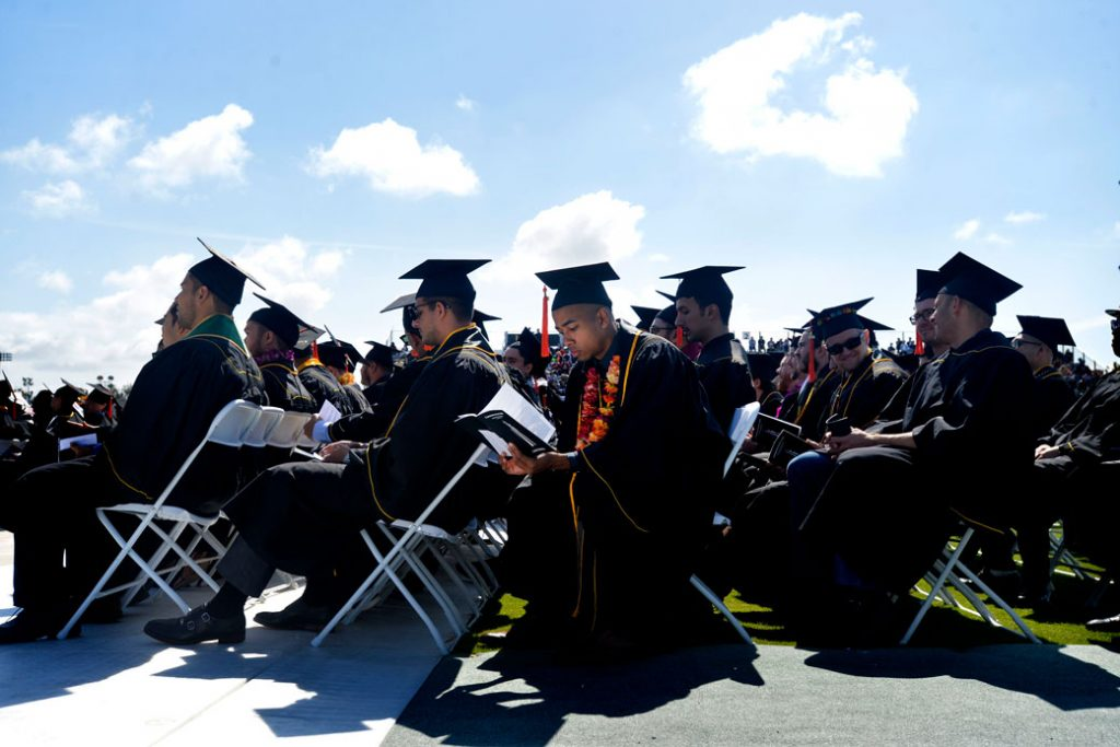 College graduates in Long Beach, California, wait their turn to walk the stage, May 2019.