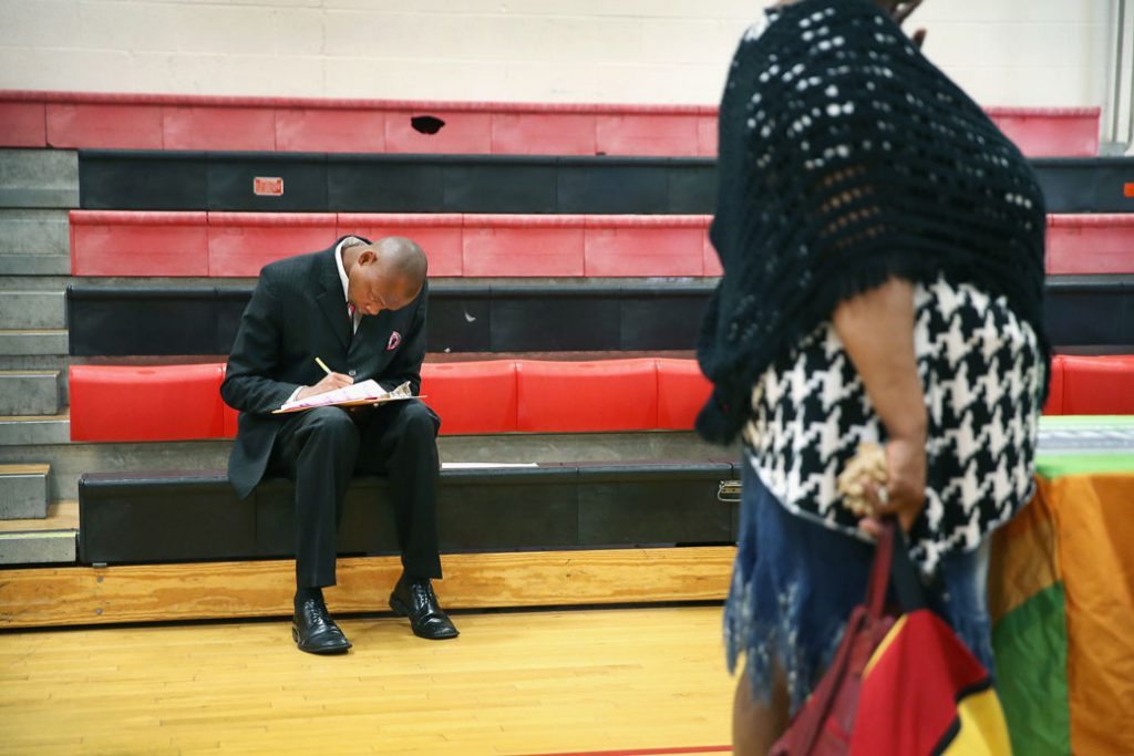 A man fills out an application at a job fair in Chicago on June 12, 2014.