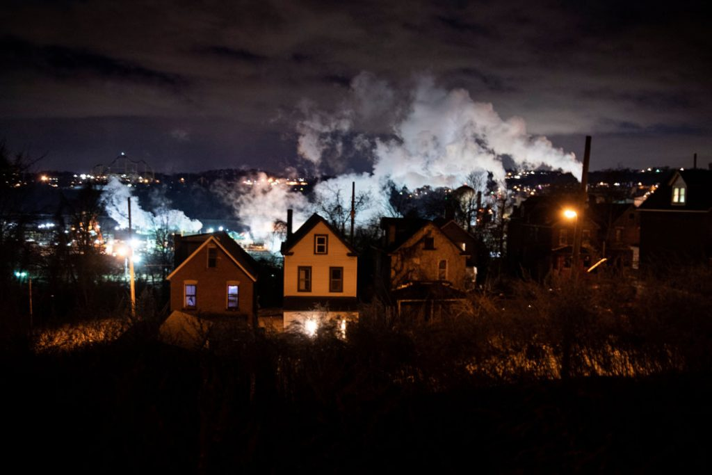 A neighborhood sits in front of the Edgar Thomson Steel Works mill in Braddock, Pennsylvania, January 2020.