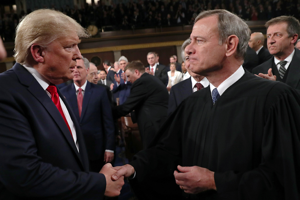 President Donald Trump shakes hands with Chief Justice John Roberts before the State of the Union address, February 2020.