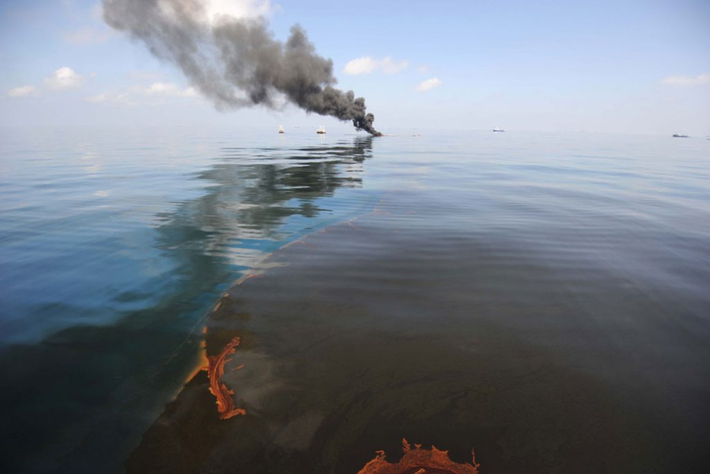 Oil burns during a controlled fire in the Gulf of Mexico following the Deepwater Horizon Spill on April 20, 2010.