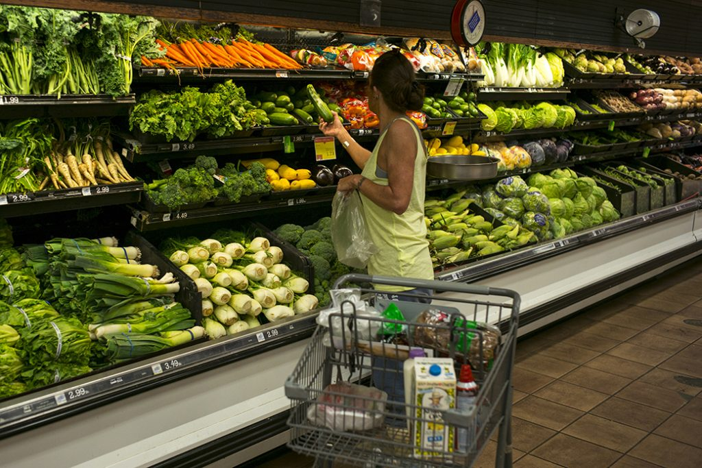 A woman shops for fresh vegetables at a supermarket in Vermont, June 2017.