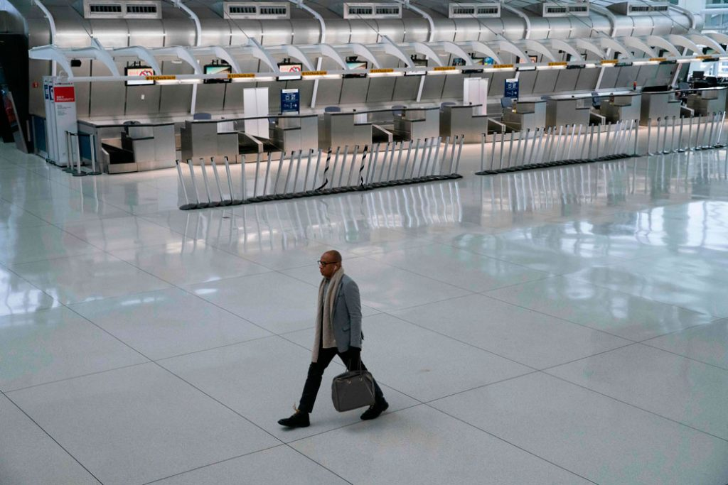 A man walks past a closed Air France counter at John F. Kennedy International Airport in New York City following President Trump's announcement of an EU travel ban on March 11, 2020.