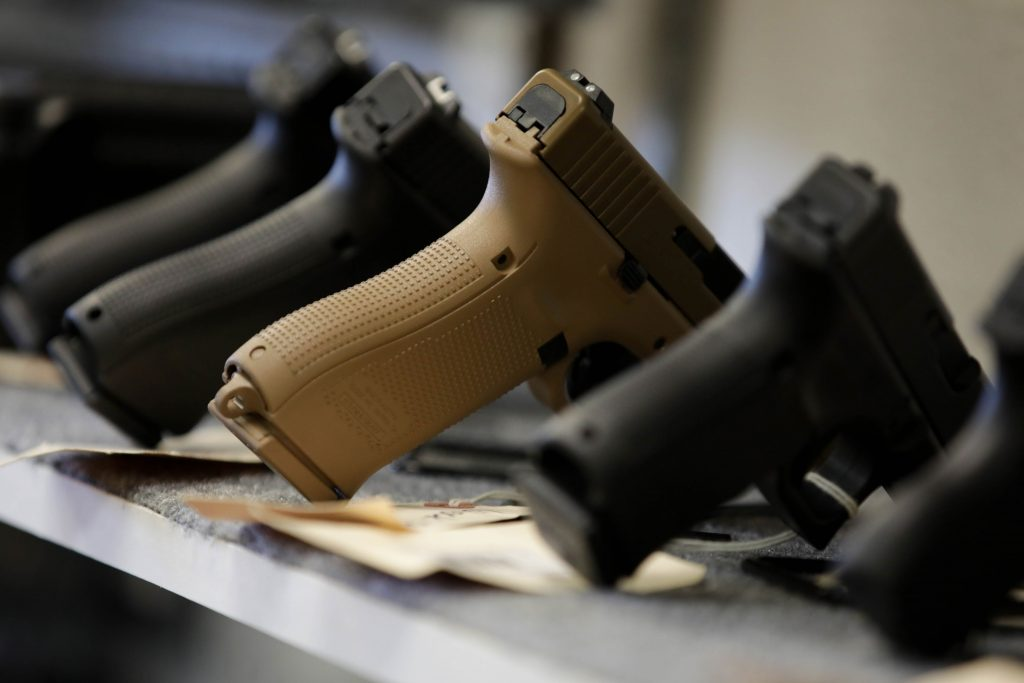 Weapons are on display at a gun shop in Manassas, Virginia, following an increase in gun and ammunition sales amid the COVID-19 pandemic, March 2020.