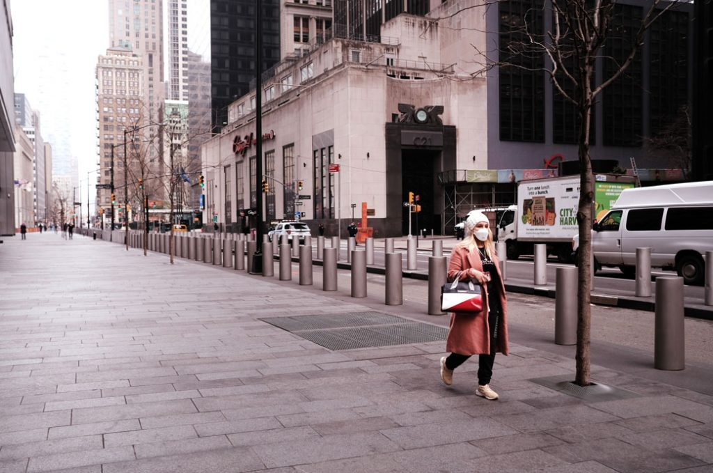 People walk through the nearly empty streets in lower Manhattan, March 2020.