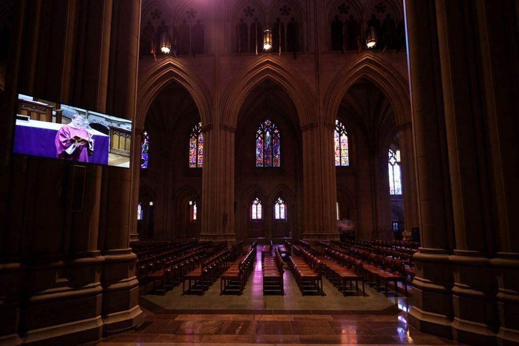 Unoccupied seats are seen as Sunday Mass at the National Cathedral in Washington, D.C., is live-webcast due to the coronavirus, March 22, 2020.