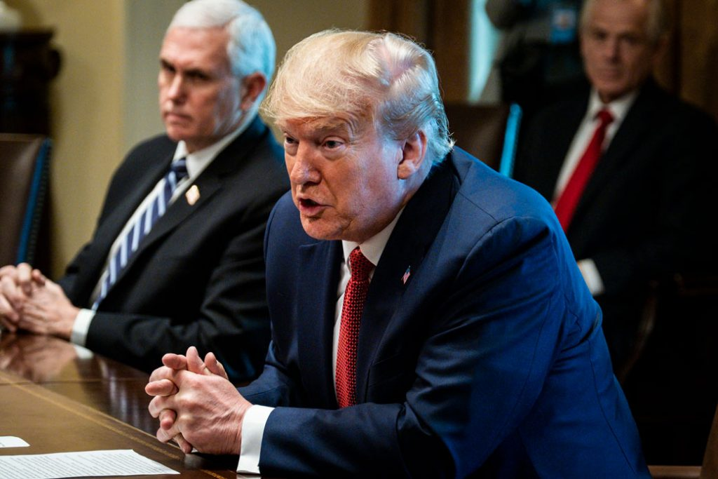 President Donald Trump and Vice President Mike Pence meet with supply chain distributors at the White House in Washington to discuss the coronavirus pandemic, March 29, 2020.