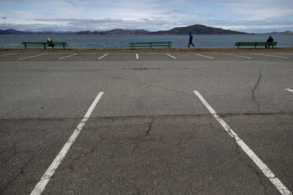 People practice social distancing at the Marina Green, March 2020.