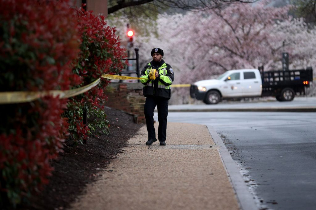 A member of the Metropolitan Police Department closes off areas surrounding the Washington Monument and National Mall due to concerns over the spread of COVID-19, March 2020.