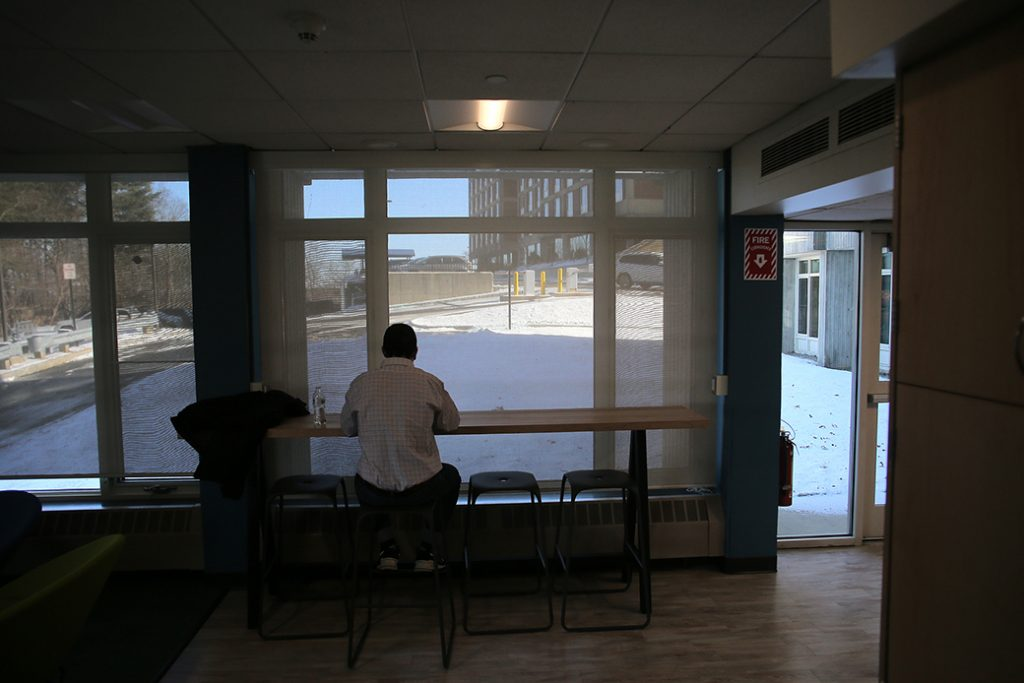 A student sits inside a campus building at his college in January 2019.