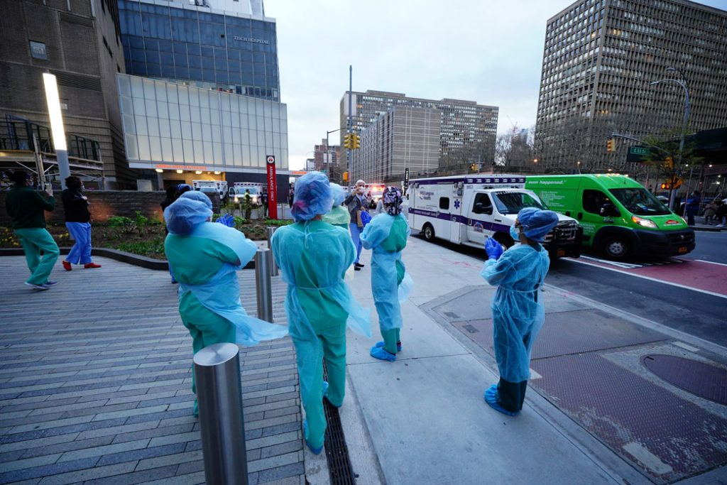 Frontline medical workers are applauded by New Yorkers as the city battles against the COVID-19 pandemic, April 2020.