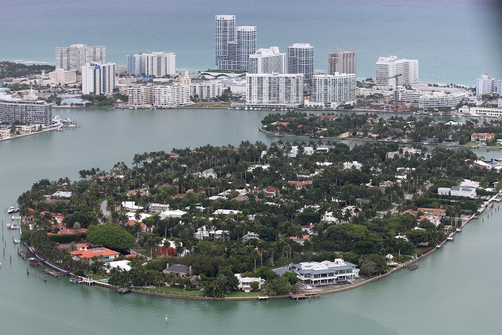 Single-family homes on islands and condo buildings on oceanfront property are seen in the city of Miami Beach, June 2014.