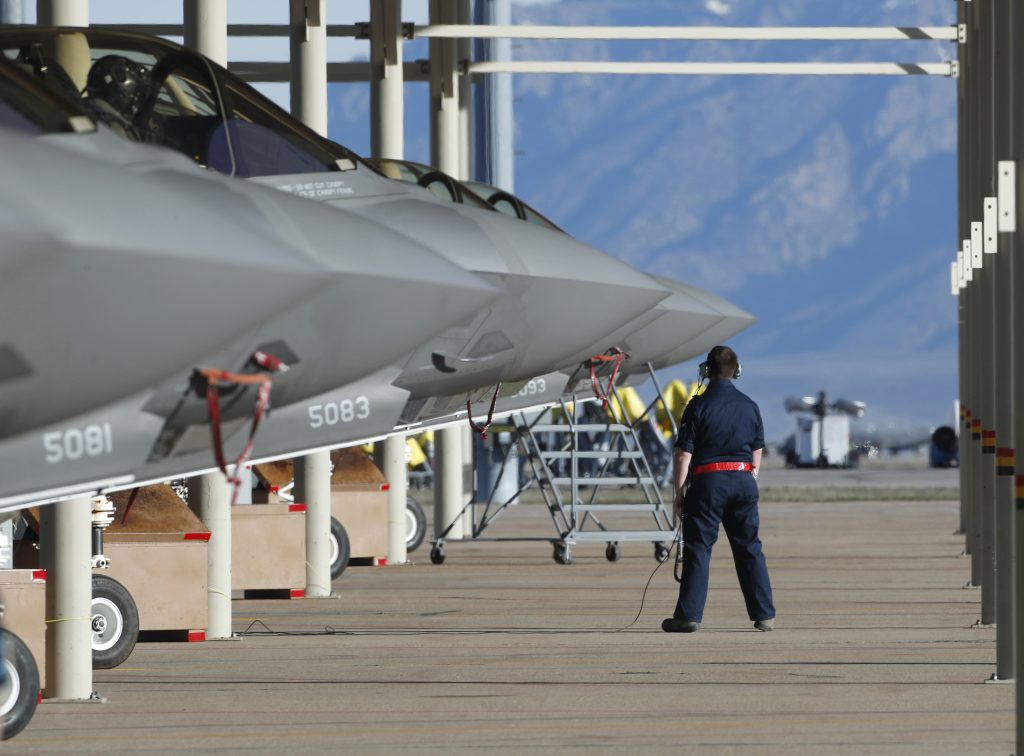 OGDEN, UT - MARCH 15: Ground crew members prepare an F-35 fighter jet for a training mission at Hill Air Force Base on March 15, 2017 in Ogden, Utah. Hill is the first Air Force base to get combat ready F-35's. They currently have 17 that might be deployed in the fight against terrorism and ISIS in the near future. (Photo by George Frey/Getty Images)