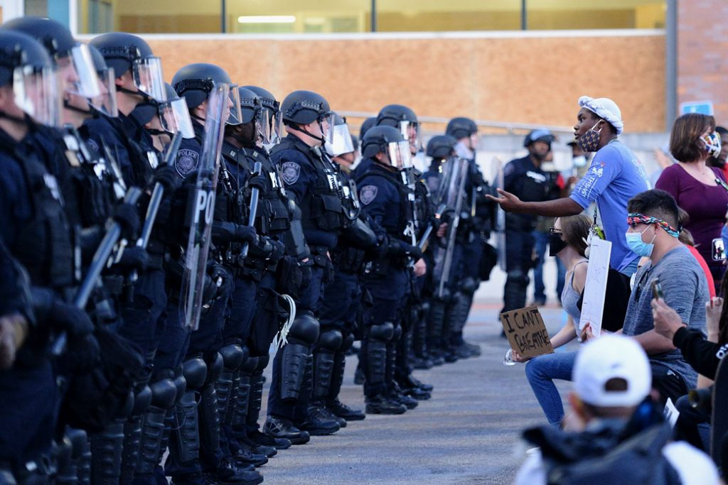 A protestor faces off with law enforcement during a protest on May 31, 2020, in Ferguson, Missouri.