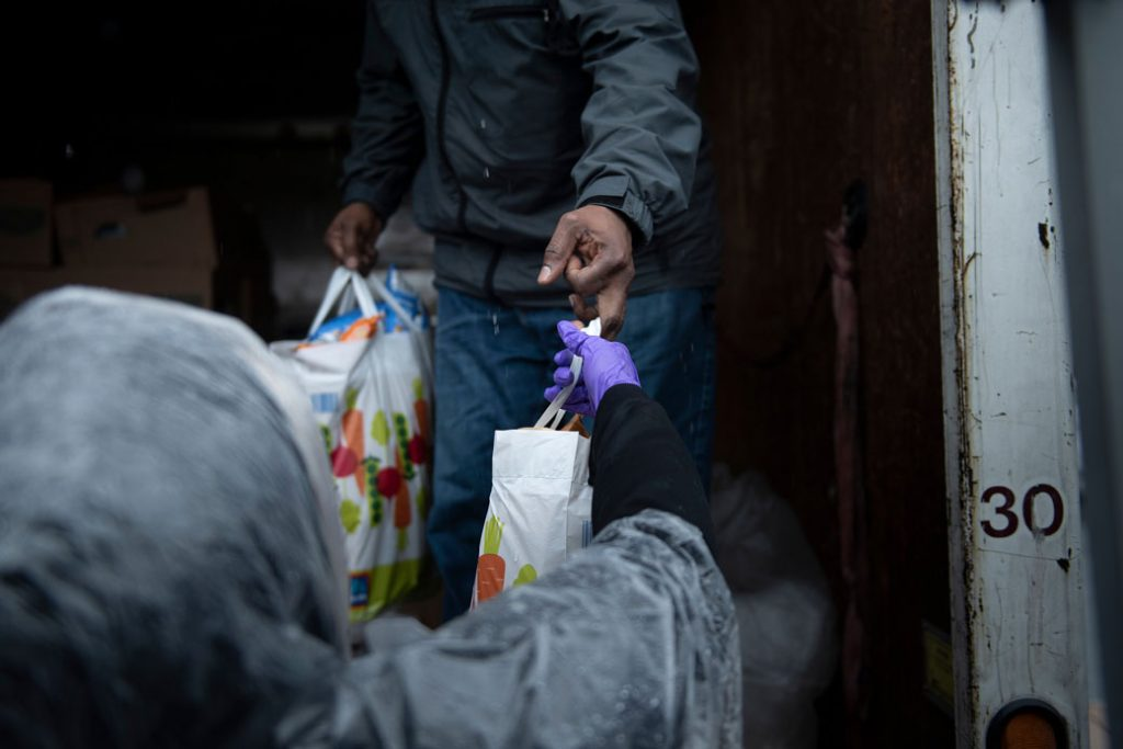 Volunteers unload food to hand out to those in need, included people affected by the coronavirus pandemic, in District Heights, Maryland, April 2020.