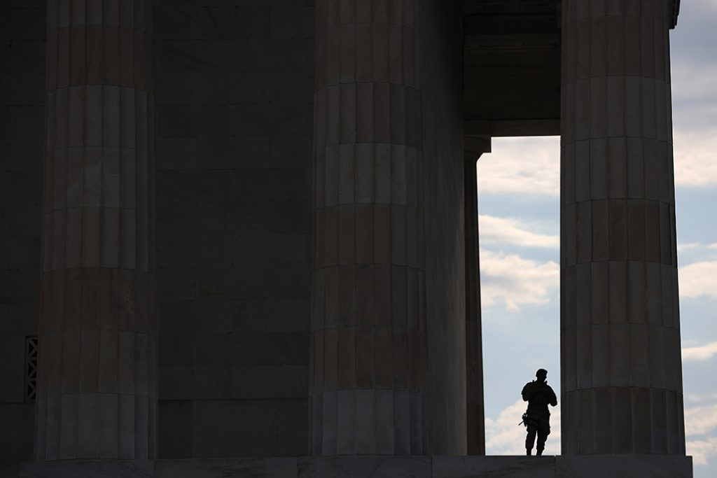 A member of the D.C. National Guard takes advantage of the shade at the Lincoln Memorial as demonstrators citywide participate in peaceful protest against police brutality and the death of George Floyd, June 3, 2020 in Washington.
