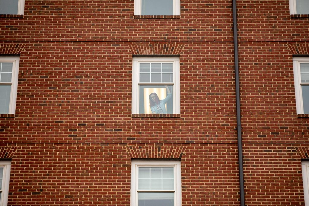 A Virginia student tries to open her dormitory window, March 2020.