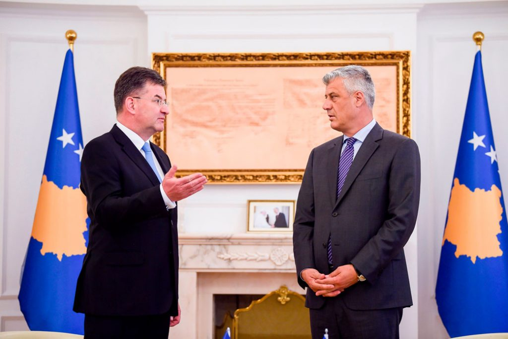 Miroslav Lajcak, the EU special representative for the Pristina-Belgrade dialogue, left, and Kosovo President Hashim Thaci chat following their meeting in Pristina, Kosovo, on June 16, 2020.
