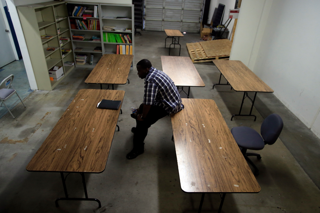 A former prisoner who is now in search of work prepares to meet with a counselor at a skills training center in Compton, California, November 2014.