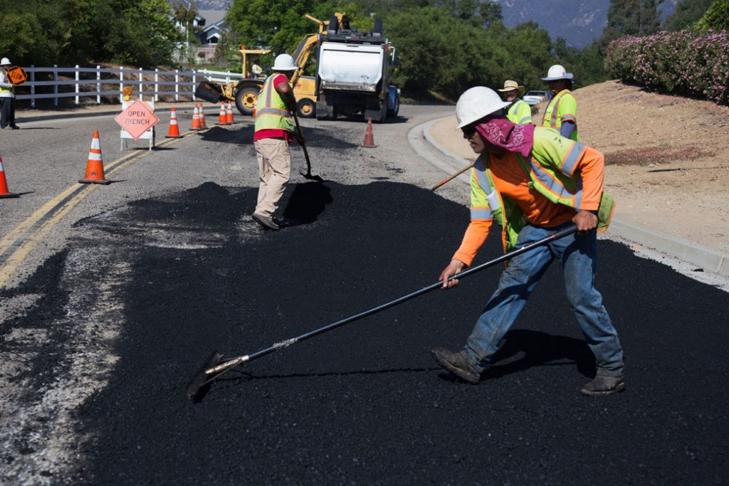 Workers repave a road in Oak View, California, October 2013.