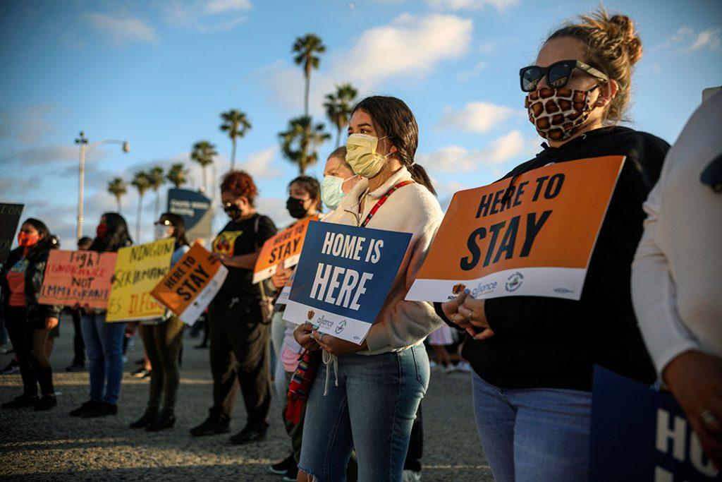People hold signs during a rally in support of the U.S. Supreme Court's ruling in favor of Deferred Action for Childhood Arrivals, in San Diego, June 18, 2020.