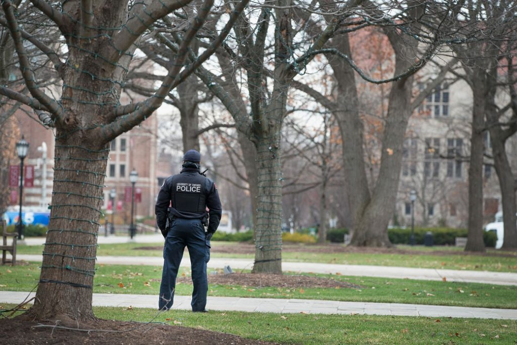 A police officer stands watch on a college campus in Chicago on November 30, 2015.