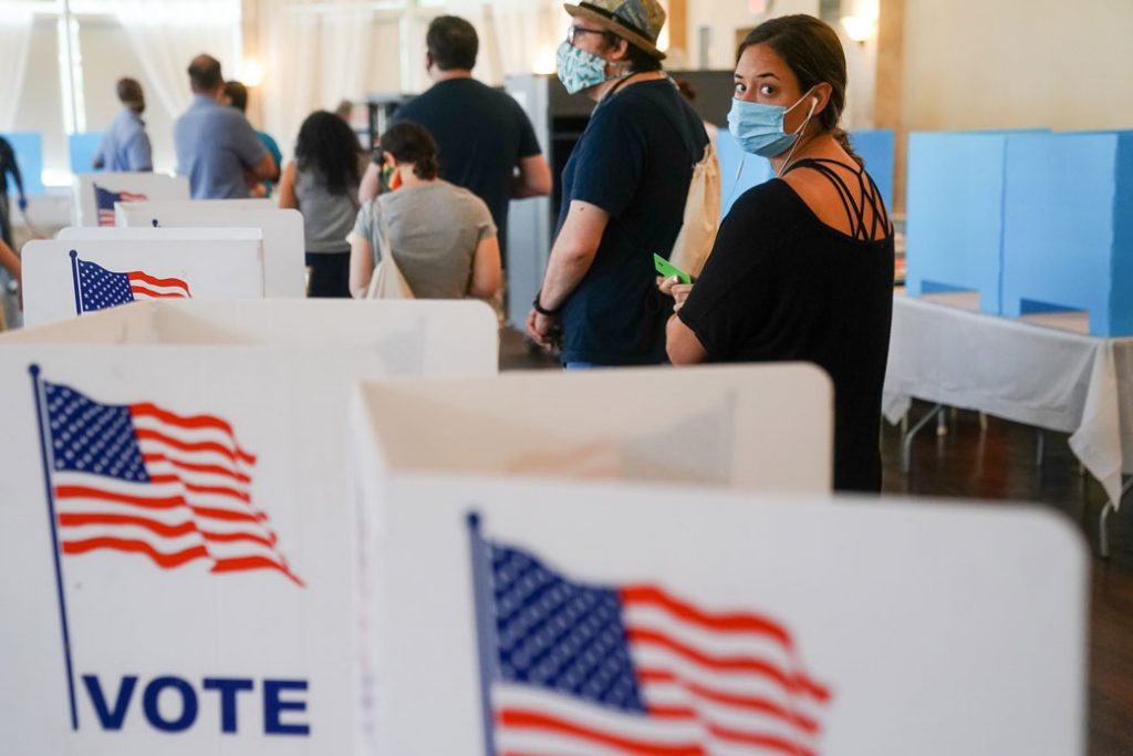 People wait in line to vote in Georgia's primary election on June 9, 2020, in Atlanta.