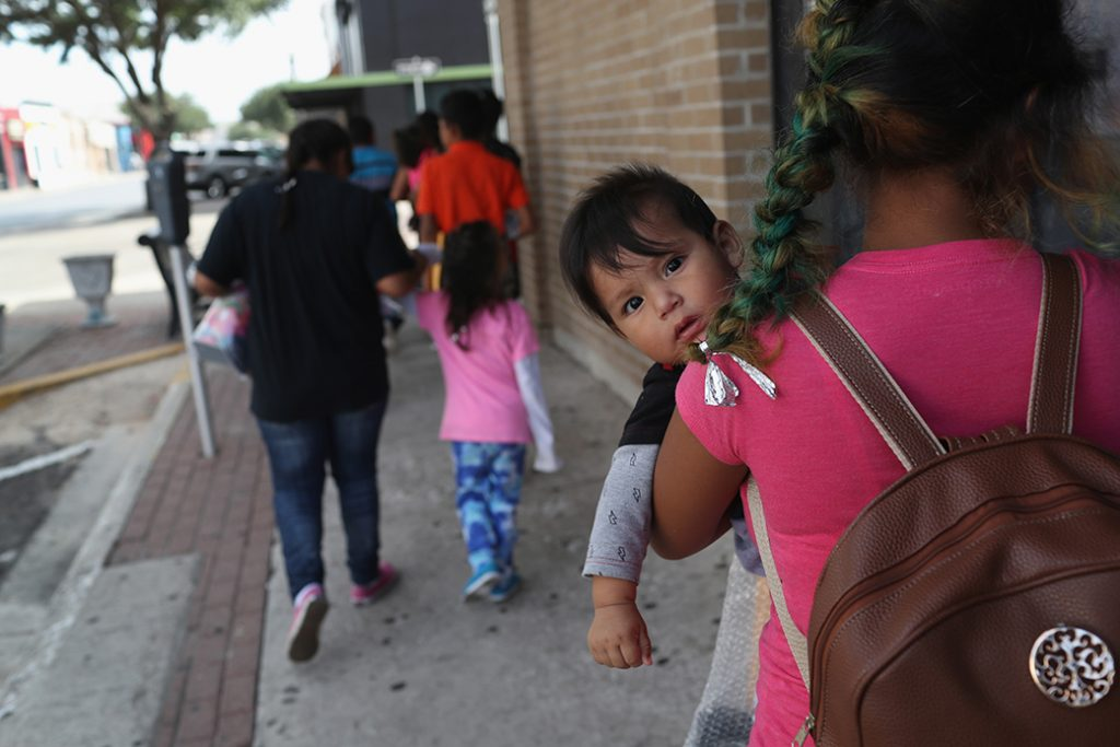 Central American immigrant families depart the custody of U.S. Immigration and Customs Enforcement, pending future immigration court hearings, June 2018, in Texas.